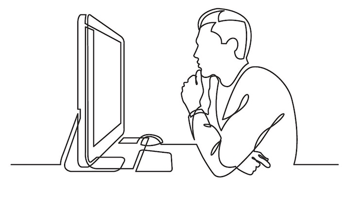 パソコンを見つめる男性
